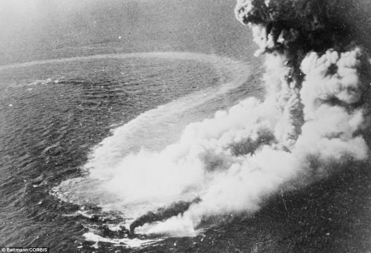 Japanese Pearl Harbour: A Grumman Avenger drops a bomb on his this Japanese destroyer, veiled in a gigantic cloud of smoke steam and foam. It was one of many enemy ships that were sent to the bottom in the smashing task force raid
