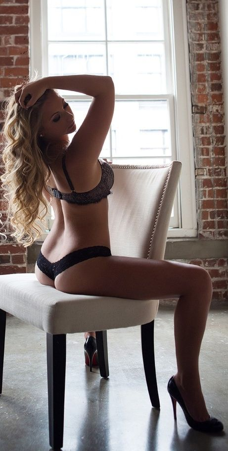 straddle a chair .. military boudoir photo idea for your soldier .. send your soldier a picture that'll make him remember what he's fighting for