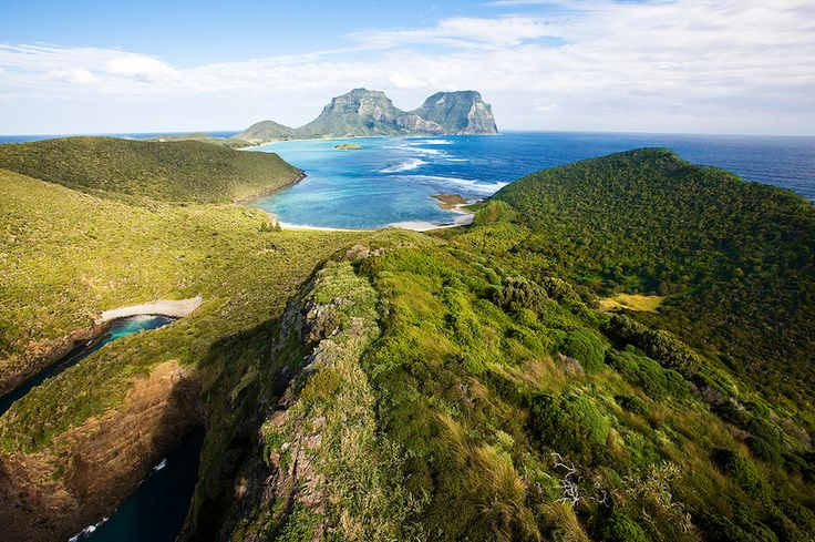 Lord Howe Island, Australia  Located two hours off the coast of Sydney, Lord Howe Island is not only remote geographically, but no more than 400 people are allowed to visit it at any given time. Accordingly, it looks like a literal paradise—from flawless beaches, a lagoon so blue it seems like a joke, a coral reef, volcanic peaks, rainforests, and wildlife that's native only to the island. If dinosaurs were ever holding out in secret, they'd probably pick Lord Howe Island.: Beautiful Places, Earth Day, Great Barrier Reefs, The Buckets Lists, Photo, Lord Howe Islands, Coral Reefs, Islands Australia, Rainforests