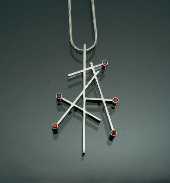 Red sapphire geometric pendant
