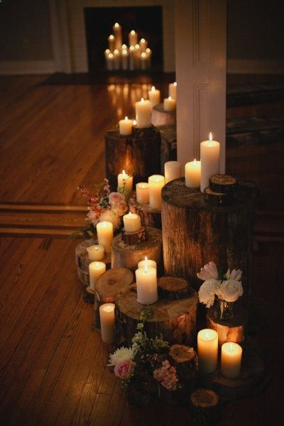 Christmas winter cozy rustic cabin elegant romantic candle lit led pillar candles and tree stumps for layering. Beautiful lovely sweet romantic