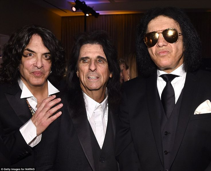 What a line-up: Cooper, 68, posed with fellow rockers Paul Stanley (left) and Gene Simmons (right)