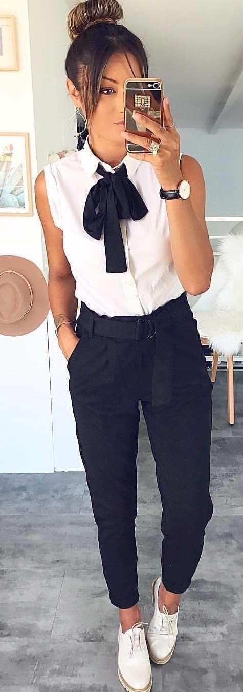 Amazing #spring #outfits woman wearing white button-up shirt with bow, black pants, and …