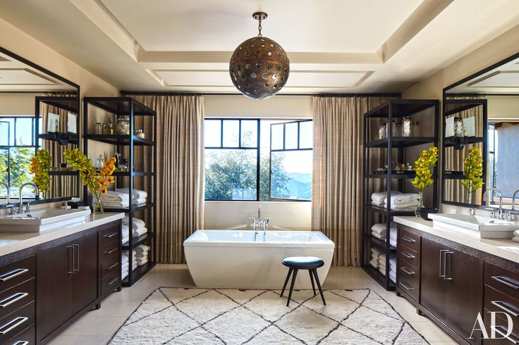 Love Kourtney Kardashian's serene neutral-toned bathroom? See all the fixtures and accessories to get the look.