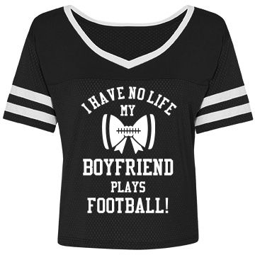 "My Boyfriend Plays FB! | Hey football girlfriend! Wear a funny and trendy crop top jersey to your boyfriends games or to school. This design has a bow with football laces on it. ""I have no life, my boyfriend plays football"". Yup, pretty much sums up what it's like to be a football girlfriend."