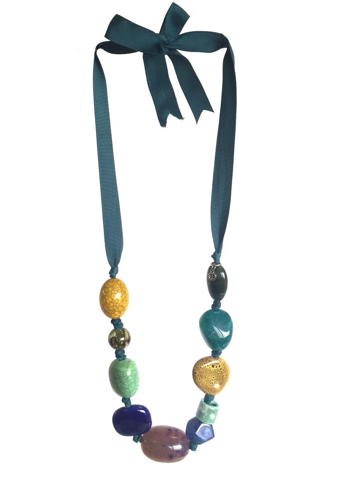 One Button necklace with mixed ceramic/acrylic beads on grosgrain ribbon #teal #toffee #gorgeousgreens #necklace #accessories #onebutton Click here to see more products from the One Button shop.