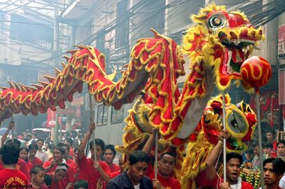 Chinese dragon head parade | In China the dragon is held in high esteem for its supernatural power ...