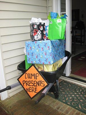 This pin inspired me to use a wheelbarrow on the deck to put empty bottles in. A good way to tie the wheelbarrow into the construction theme without having it where it could be tipped over. We used a sign in the living room for the area to dump gifts in.