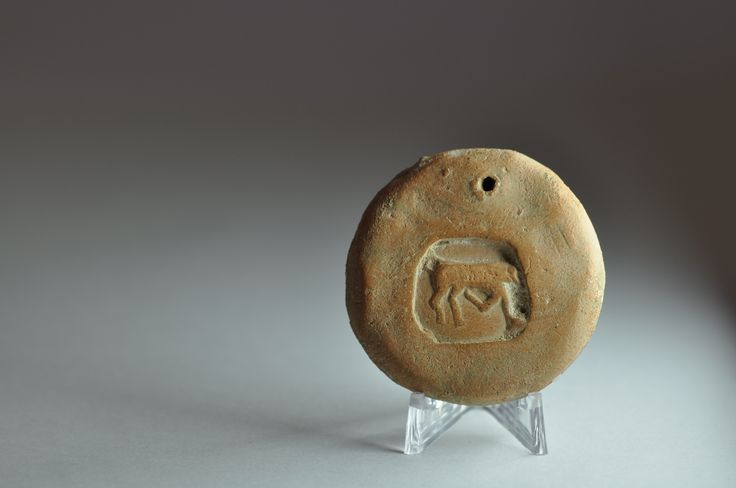 Greek loom weight with cow, 4th century B.C. Eastern Mediterranean, 4 cm diameter. Private collection