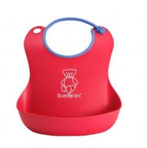 BabyBjorn Soft Bib. The soft bib can be used for a long time due to it's adjustable snap. The spilt food remains in the pocket even if your baby moves around.