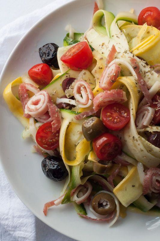 15 Minute Zucchini Noodle Salad Recipe! Here's a low carb recipe that tastes like a perfect antipasto plate: with salami, provolone, olives, and a light Italian vinaigrette. The zoodles are light, but the meat and olives give it heartiness and staying power!