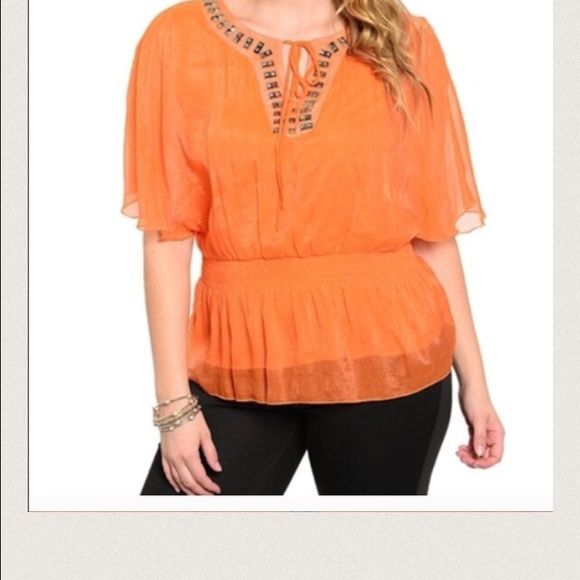 Orange top Orange blouse. It's lined. Has nice bling at neck line. Says 3x but best for 1x. New without tags. Retail item Tops Blouses