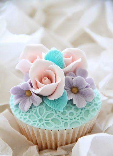 Pastel cupcake with gumpaste flowers.