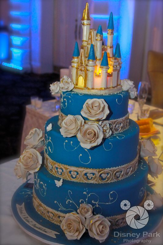 Disney Wedding Cake- I really love this cake but dragonflies instead of butterflies, the flowers lilac the cake in dark purple and the scrolls in green! With Beauty and the Beast on top!