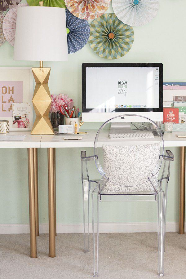 Spray painted IKEA desk in this chic office space
