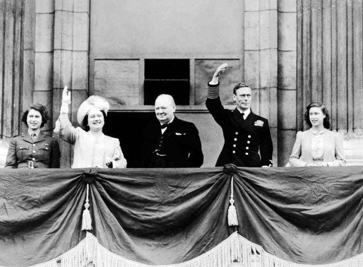 MAY  8 1945 End of the War in Europe – 'VE Day' . HM King George VI and Queen Elizabeth with Princess Elizabeth and Princess Margaret joined by the Prime Minister, Winston Churchill on the balcony of Buckingham Palace, London on VE Day.