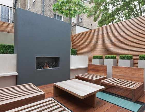 Minimalistic modern design for outdoor area with wall mounted gas fireplace