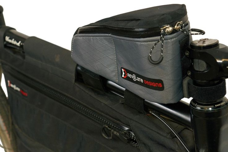 The Gas Tank™ is a high end, high volume top tube bag for carrying a ton of food and other gear. It offers substantial storage in an easy access case. Zip open a side for one-handed access while riding or open up both when stopped for full panel access to the contents.