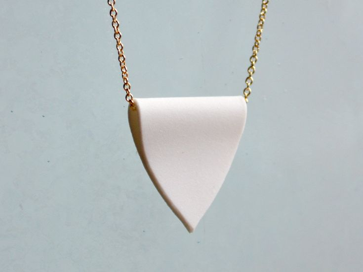 A Porcelain Pendant - Simple White Crest and Gold Chain Necklace. $68,00, via Etsy.