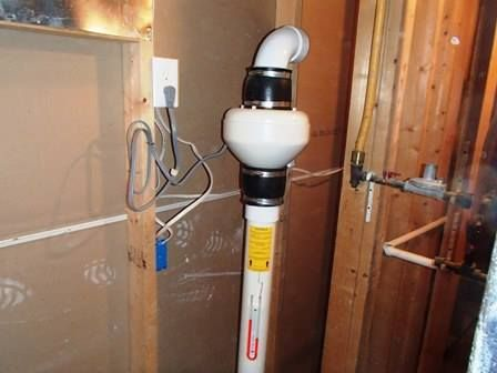 here is a mitigation system installed about as wrong as you can get fan inside the home and discharging right into the basement