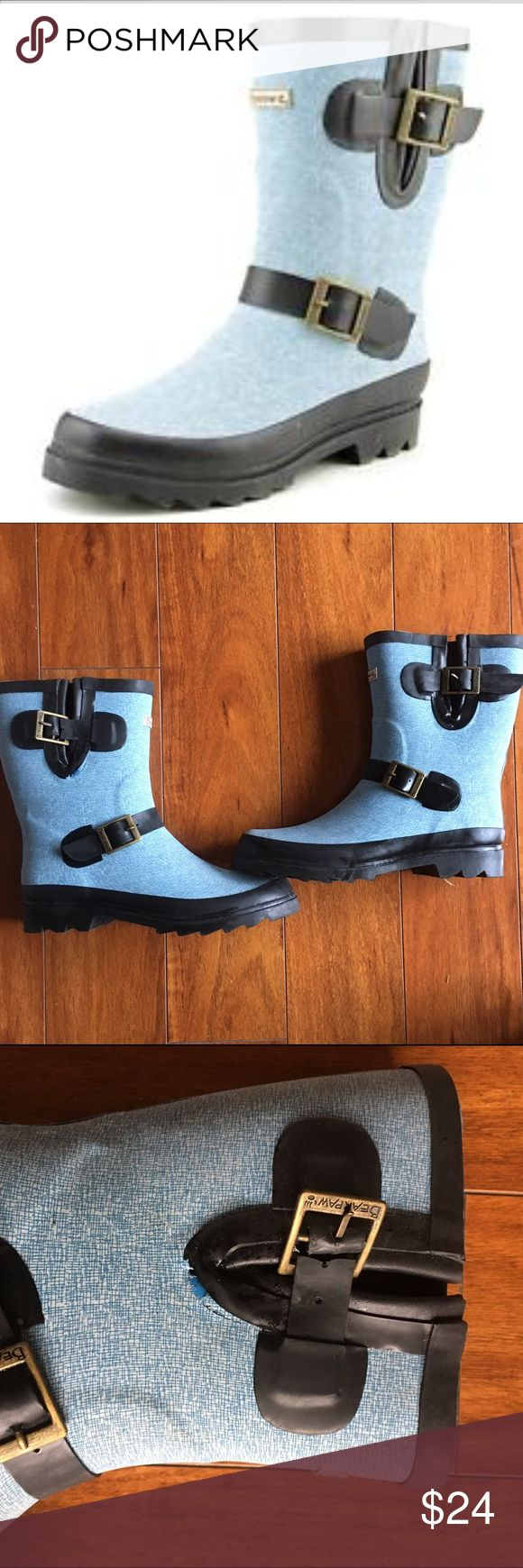 Bearpaw rain boots Worn once for an hour. Bear Paw rain boots Sz 9. Medium light blue with black trim. Great traction on the bottom. Purchased from Nordstrom Rack. Flaws to note-see 3rd pic-buckle strap is split. You don't notice this when wearing. There's also a manufactures defect under the black portion. Again not really noticeable. These are so cute but I never reach for them. BearPaw Shoes Winter & Rain Boots