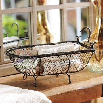 Metal Bathtub Basket at Kirklands.com for $17 is identical to the Pottery Barn Bathtub Catchall that is $39!