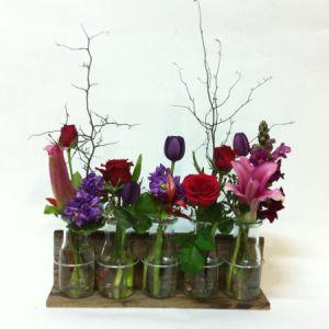 Bottled floral rack in jewelled tones