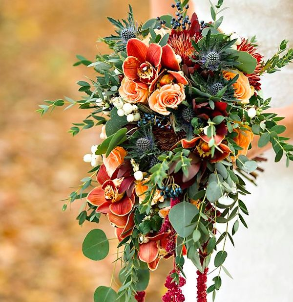 Cascading Fall Bouquet: Let the flowers flow! Create a beautiful arrangement by letting the flowers hang in a cascade. Vines and greenery are perfect for creating a waterfall bouquet.