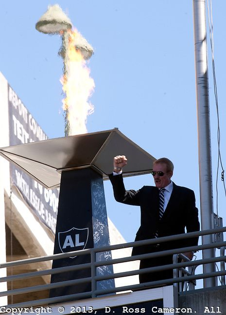 Former Oakland Raiders Hall of Fame linebacker Ted Hendricks pumps his fist after lighting the flame in remembrance of late Raiders owner Al Davis before the start of an NFL football game between the Raiders and Jacksonville Jaguars, Sunday, Sept. 15, 2013 at O.co Coliseum in Oakland, California. The Raiders won, 19-9.