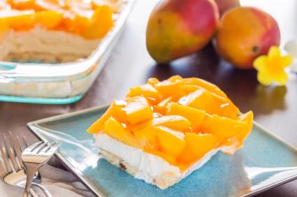 Decadent cheesecake topped with fresh mango and orange jello with macadamia nut crust :)