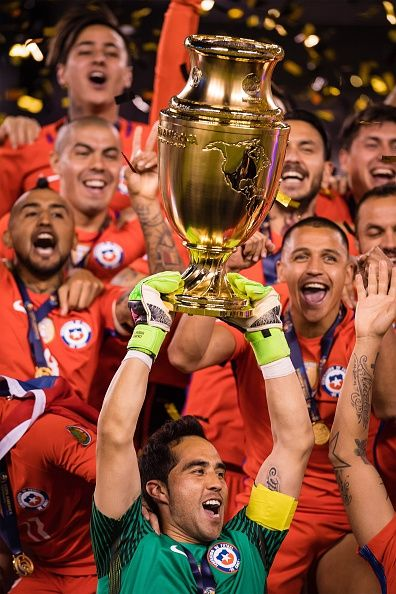 #COPA2016 #COPA100 Players of Chile celebrate with the trophy after the championship match between Argentina and Chile at MetLife Stadium as part of Copa America...