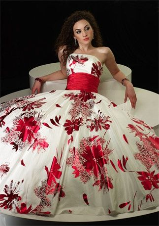 CoCo is Haute - 50's inspired gown.  Strapless bodice and full bouffant skirt of white taffeta, accented with large red sprays of flowers and wide red taffeta cummerbund.