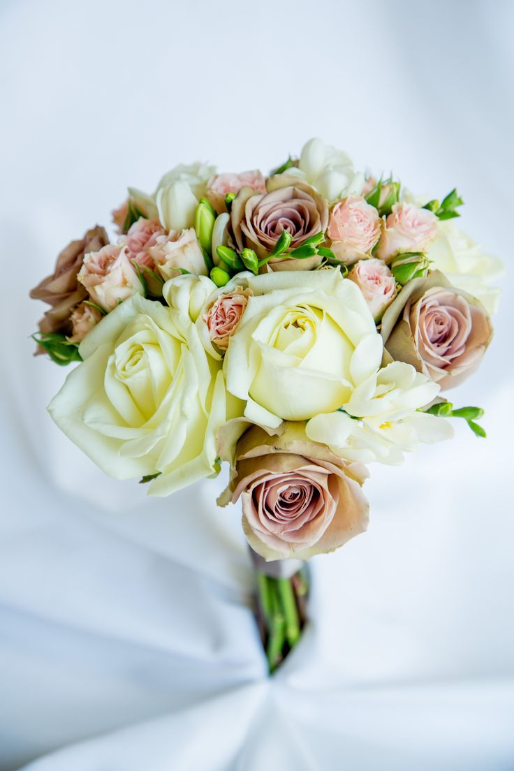 Vintage bridal bouquet. Amnesia roses, avalanche roses, cream spray roses and white freesia