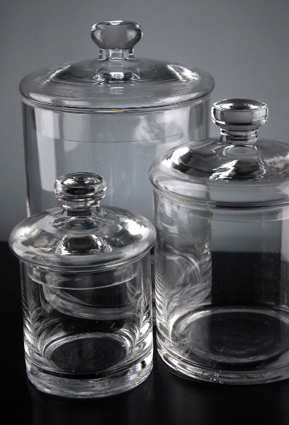 Inexpensive glass jars for bathroom storage.  Add a label or some etching and it would be fabulous!