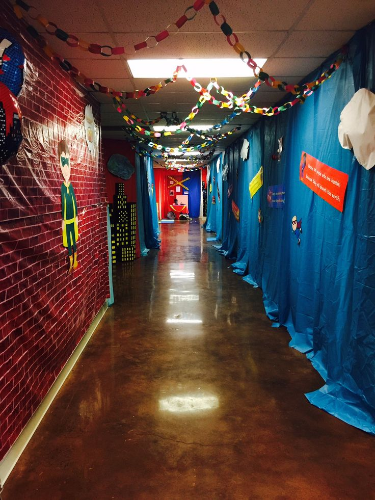 Love this hallway! Brick Wall Plastic Backdrop and those colorful paper chains will make you a decorating hero for VBS! cokesburyvbs.com