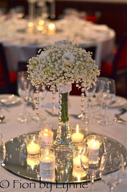 Pretty and simple. Baby's breath center pieces with little candles