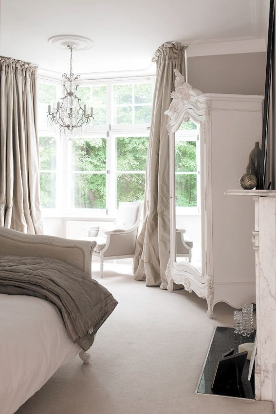 fabulous painted, crested armoire in this divinely pretty neutral bedroom (love the puddled curtains) - The Paper Mulberry: Essentially French!