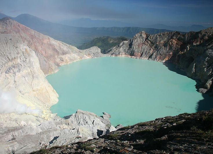 Ijen is one of the mountains visible in that previous photo taken from Bali, and Kawah Ijen is the crater of the volcano, famous for its turquoise colored lake of sulfuric acid. Bali, Indonesia.