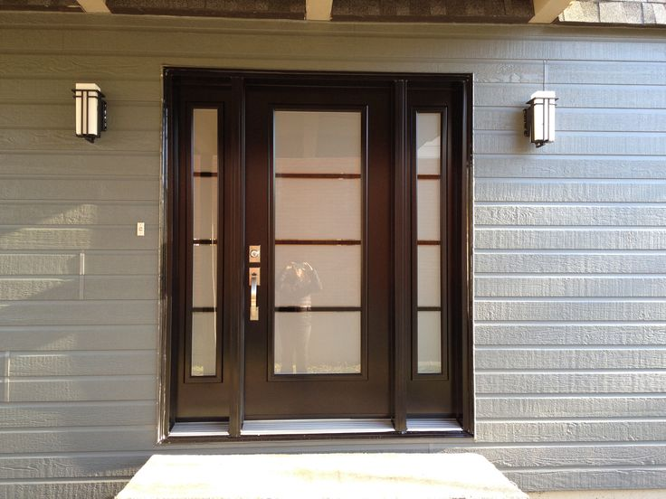 Canexel Ridgewood D-5 in granite color, Pure door by Novatech, Abbey lights by Z-Lite, Tavaris handle and lock by Weiser.