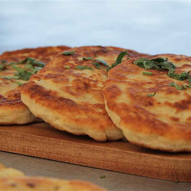Try this Coriander and Garlic Chapatis with Spicy Potato Pockets  recipe by Chef Angela. This recipe is from the show The Great Australian Bake Off.