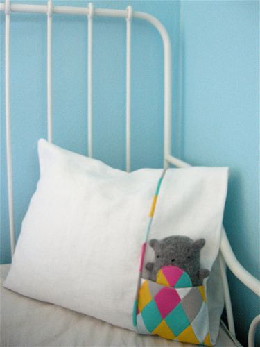 Love this idea! Pillowcase with a pocket for your little one's favorite stuffed toy