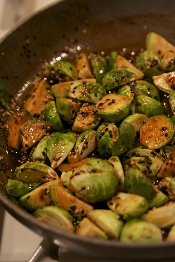 Brussel sprouts with soy, honey and red pepper flakes!  Sticky, sweet and spicy.