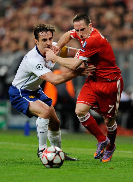 Franck Ribery of Bayern Muenchen challenges Gary Neville of Manchester United during the UEFA Champions League quarter final first leg match match between Bayern Muenchen and Manchester United at the Allianz Arena on March 30, 2010 in Munich, Germany.