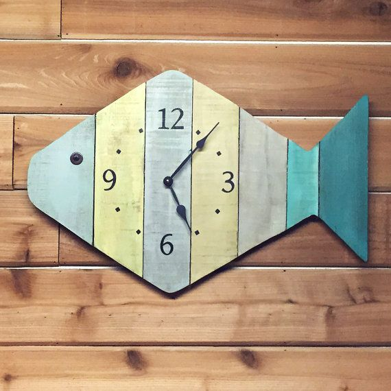 This Nautical Themed Painted Fish Beach Wall Clock is created from reclaimed lumber (Pallet wood) and glued to plywood backing. It is considered tropical wall art by some and Folk Art by others, but it is actually fish wall decor.  **SHOP SPECIAL: Get a FREE PERSONALIZED message - up to three lines of text similar to photo #2 - just message us with your choice of text.  The folk art wall clock with beachy decor color scheme will catch the attention of all who visit your Nautical Themed room…