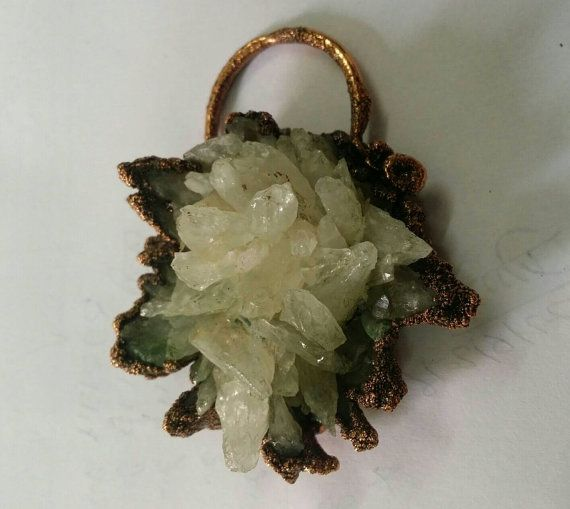Check out this item in my Etsy shop https://www.etsy.com/uk/listing/465256895/raw-crystal-pendant-netural-crystal