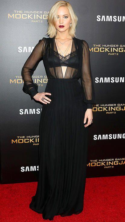 Jennifer Lawrence in a sexy sheer Schiaparelli black dress with lacy bra