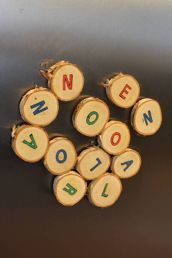 Check out this item in my Etsy shop https://www.etsy.com/listing/479880190/handstamped-letter-log-slice-magnets