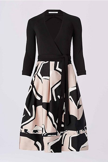 The DVF Jewel wrap features a deep v-neck, 3/4 sleeve, and a fuller skirt in a playful graphic print. Falls to the knee.