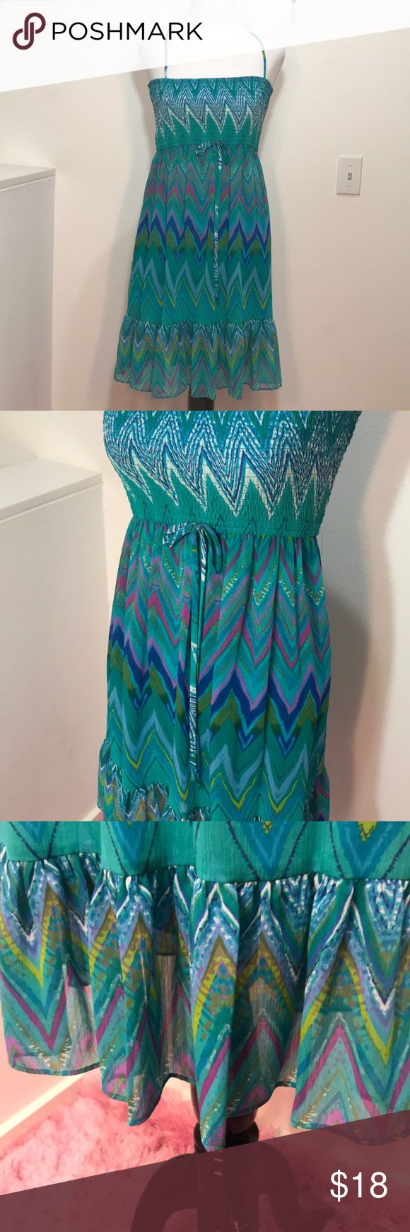NWOT City Triangles Chevron Print Dress NWOT Adorable City Triangles dress with bright fun chevron print. Bust is smocked, so it could fit a variety of sizes. Straps can easily be tucked in to wear as a strapless style. Although it's a juniors size it could definitely fit a women's small or extra small City Triangles Dresses