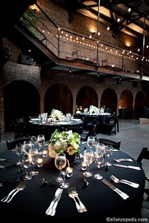 Black tablecloths at wedding